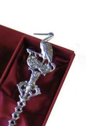 Zilveren geboortelepel met ooievaar