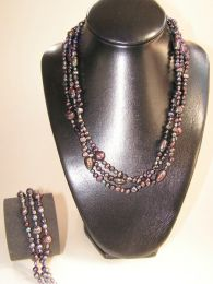 Set olie kleurige pareltjes collier met armband