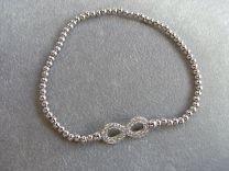 Zilveren armband met bolletjes en infinity teken met zirkonia