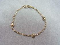 Gouden kinder armbandje met hartjes