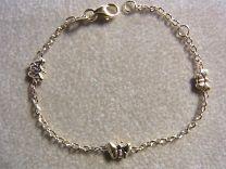Gouden kinder armbandje met 3 vlindertjes 11 tot 13 cm